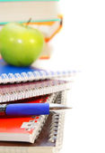 Apples and school subjects on a white background. — Stockfoto