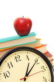 Watch, an apple and books on a white background. — Stockfoto