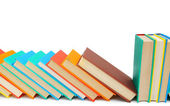 Multi-coloured books on a white background. — Stock Photo