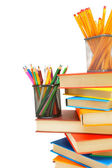 Pencils, felt-tip pens in baskets and books on a white background — Stock Photo