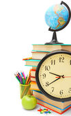 Back to school. Watch, the globe and other school subjects on a white background. — Stock Photo