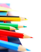 Pencils... Multi-coloured pencils and writing-books on a white background — Foto Stock