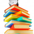 Multi-coloured books and alarm clock on the white. — Stock Photo