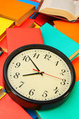 Watch and multi-coloured books. — Stock Photo