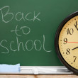 Stock Photo: Watch against school board. Back to school.