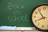 Watch against a school board. Back to school. — Stock Photo
