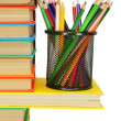 Books and pencils in a basket. On a white background. — Stock Photo