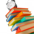 Alarm clock on multi-coloured books. On a white background. — Stock Photo #32460387