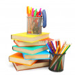 Stock Photo: Pencils and felt-tip pens in baskets with books. On white background.