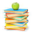 Apples and multi-coloured books. On a white background. — Photo