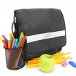 Stock Photo: School bag, apple and school accessories on white background.