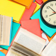 Stock Photo: Watch and many multi-coloured books.