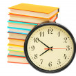 Stock Photo: Watch and multi-coloured books on white background.