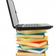 Laptop and many multi-coloured books. On a white background. — Stock Photo