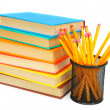 Basket with pencils and books. On a white background. — Stock Photo