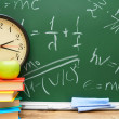 Stock Photo: Watch and apple on books. Against school board with formulas on physicist.