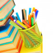Basket with felt-tip pens on books. On a white background. — Stock Photo