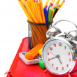 Alarm clocks and school tools on a white background. — Stock Photo