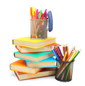 Pencils and felt-tip pens in baskets with books. On a white background. — Stock Photo