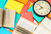 Watch and many multi-coloured books. — Stock Photo