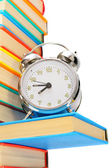 Alarm clock on books. On a white background. — Stock Photo