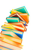 Mountain from multi-coloured books on a white background. — Stock Photo
