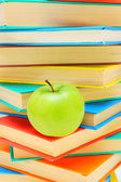 Apple and books. — Stock Photo