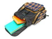 školní batoh a knihy uvnitř. na bílém pozadí. — Stock fotografie