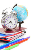Back to school. The globe, an alarm clock and school subjects on a white background. — Photo