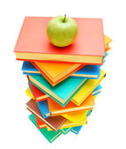 Apple on multi-coloured books. On a white background. — Stock Photo