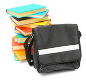 School bag and multi-coloured books on a white background. — Stock Photo