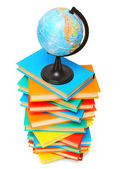 Globe on a pile of multi-coloured books. On a white background. — Stock Photo