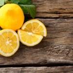 Lemons. On wooden board. — Stock Photo #32815481