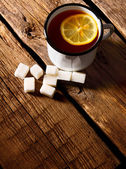 Black tea with lemon and sugar. — Stock Photo