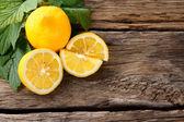 Lemons. On wooden board. — Stock Photo