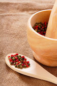 Pepper in mortar on an old fabric. — Stock Photo