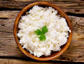 Cottage cheese on wooden board . — Stockfoto