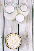 Dairy products on wooden background. — Stock Photo