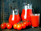 Tomatoes and juice — Stock Photo