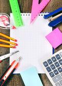 Notebook and school tools around. — Φωτογραφία Αρχείου