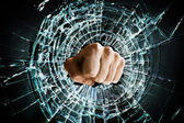 Broken window fist — Stock Photo