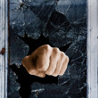 Shattered glass fist — Stock Photo #38266147