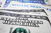 Social Security cards and money — Stock Photo