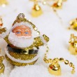 Santa Claus figurine and Christmas golden bells — Stock Photo