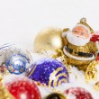 Santa Claus figurine and Christmas balls — Stock Photo