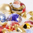 Santa Claus figurine and Christmas balls — Stock Photo #14284629