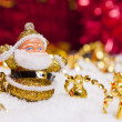Stock Photo: Happy SantClaus figurine and Christmas golden bells
