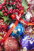 Winterberries and colorful baubles — Stock Photo