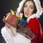 Santa girl with Christmas gifts. — Stock Photo