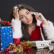 Stressed Santa girl at work — Stock Photo